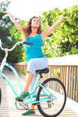 Carefree Young Woman On Bike At The Beach — Stock Photo