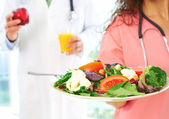 Nurse and Doctor with health food — Stock Photo