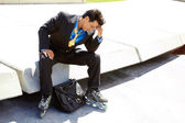 Tensed Young Businessman In Rollerblade — Stock Photo
