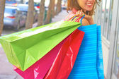 Young Woman With Multi Colored Shopping Bags — Stock Photo