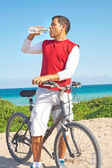 Hispanic Man Taking a Break From Biking Quenching His Thirst — Stock Photo