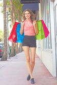 Smiling Woman With Shopping Bags On the Street — Foto de Stock