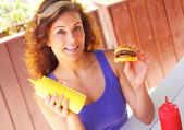 Woman Holding Mustard Sauce Bottle And Mini Burger — Stock Photo
