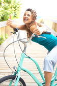 Happy Female With Bicycle Smiling Giving Thumbs Up — Stock Photo