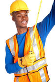 African-American male construction worker with measuring tape — Stock Photo