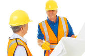 Two Construction Workers Planning Out the Job — Stock Photo