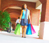 Beautiful Smiling Woman Holding Shopping Bags — Stockfoto