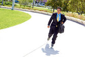 Businessman Rollerblading In Urgency — Stock Photo