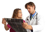 Nurse and doctor looking at x rays with bad news — Stock Photo