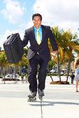 Businessman Rollerblading At Park — Stock Photo