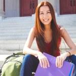 Happy Female Student Sitting On Steps — Stock Photo #30429101