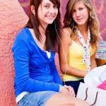 Female Friends Listening Music — Stock Photo #30429129
