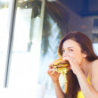 Young Female Eating Hamburger — Stock Photo