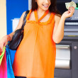 Woman with Shopping Bags And Cash — Stock Photo