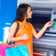 Young Woman Withdrawing Money — Stock Photo
