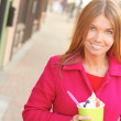 Happy Young Pretty Female Eating Frozen Yogurt — Stock Photo #30429293