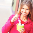 Happy Young Pretty Female Eating Frozen Yogurt — Stock Photo #30429297