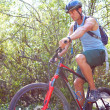 Young man mountain biking — Stock Photo