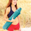 Young pretty asian female holding yoga mat — Stock Photo
