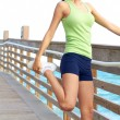Healthy young woman stretching — Stock Photo