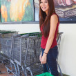 Happy Young Woman Holding Shopping Basket — Stock Photo