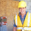 Happy Building Contractor At Construction Site — Stock Photo