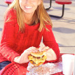 Young Woman Eating a Delicious Cheeseburger — Stock Photo