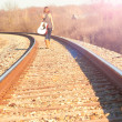 Young Lady Walking On Railroad Tracks With Guitar — Stock Photo