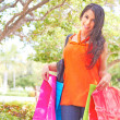Happy Woman Smiling With Shopping Bags — Stock Photo
