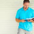 Man with Tatoo Reading The Bible — Foto Stock