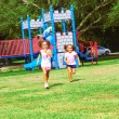 Siblings Enjoying At Park — Stock Photo #30429591