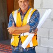 Stock Photo: Happy Building Contractor At Construction Site