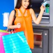 Stock Photo: WomWith Shopping Bags And Debit Card