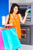 Woman With Shopping Bags And Debit Card — Stock Photo