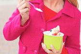 Happy Young Pretty Female Eating Frozen Yogurt — Stock Photo