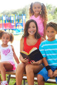 Siblings With Holy Bible At Park — Stock Photo