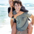 Happy young couple having fun at the beach — Stock Photo
