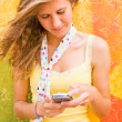 Cute happy teenage girl text messaging — Stock Photo #30430061