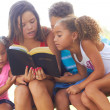 Teenage Girl Reading Bible To Siblings At Park — Stock Photo