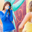 Happy cute teenage girls taking pictures — Stock Photo