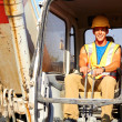 Portrait of young construction worker driving forklift — Stock Photo #30430239