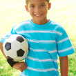 Stock Photo: Cute Little Boy With Soccer Ball At Park