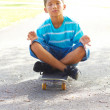 Little boy Meditating On Skateboard — Stock Photo