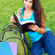 Relaxed Young Woman Reading Book — Stock Photo