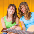Happy cute teenage girls listening to music — Stock Photo #30430285