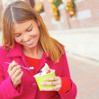 Happy Young Pretty Female Eating Frozen Yogurt — Stock Photo #30430319