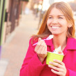 Happy Young Pretty Female Eating Frozen Yogurt — ストック写真