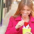 Happy Young Pretty Female Eating Frozen Yogurt — Stock Photo #30430359