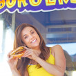 Cheerful Young Woman Posing With a Hamburger — Stock Photo