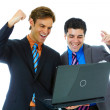 Happy young business men using laptop — Stockfoto